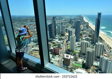 Child (girl age 04) looks at the view of Surfers Paradise from the Skypoint observation deck at the top of the Q1 on the Gold Coast, Australia.