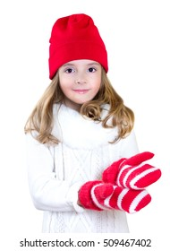 Child girl in christmas clothes empty hands isolated on white. Kid xmas advertisement concept.