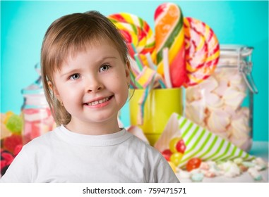 Child, girl, colorful jelly marmalade.
