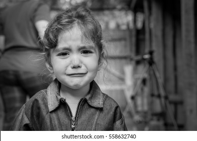The child - a girl crying. In the eyes visible tears.