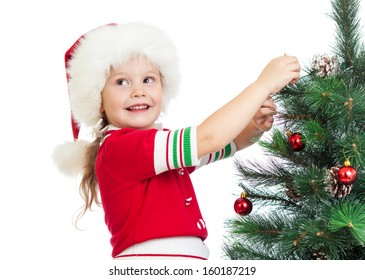 child girl decorating Christmas tree isolated on white
