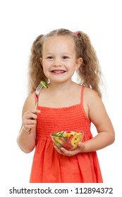 child girl eating with healthy food vegetables