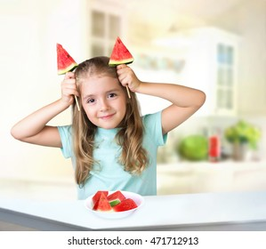 Child girl eating watermelon playing with food. Kid's healthy vitamin nutrition background empty space.
