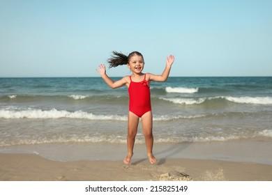 child girl enjoying ocean.