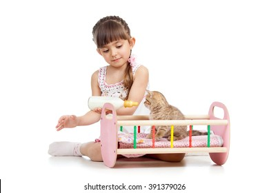 child girl feeding and playing kitten cat