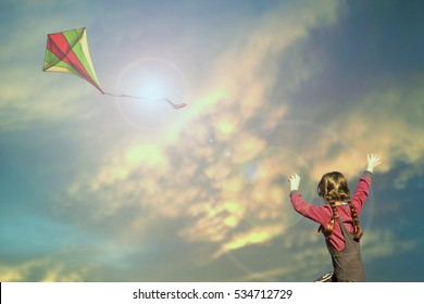 child girl flying a kite in country. fantasy kid background