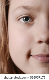 child girl half face portrait with focus on eye