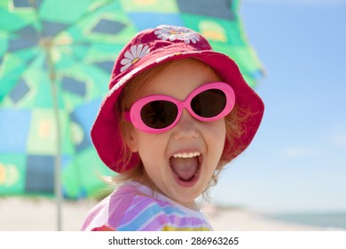 child girl happy smile healthy teeth sun glasses beach summer vacations