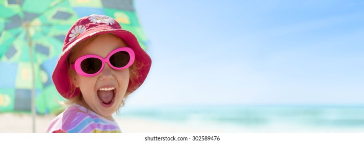 child girl happy smile healthy teeth sun glasses beach summer vacations panorama