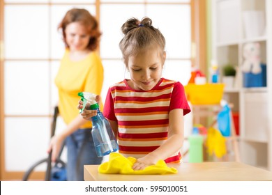 child girl and mother make cleaning in room at home