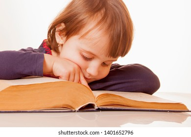 Child girl reading a book as symbol of learning, knowledge and development.
