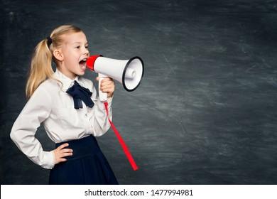 Child Girl Scream Advertisement to Megaphone, Kid In School Dress Advertising on Blackboard Background