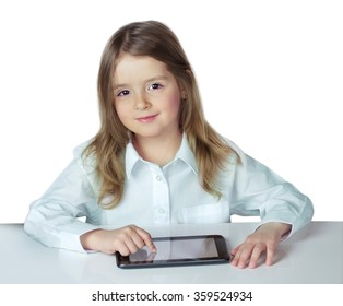 Child girl sit table ipad laptop isolated on white.Kid use electronic wireless device.