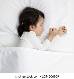 Child girl sleeping on the wooden bed in her bedroom, Baby healthy and preschool concept