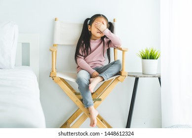 child girl stressed about family problems sit on chair at home crying, having problems with parents