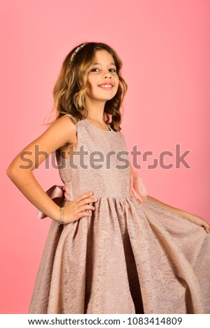 e2793097f298 Child girl in stylish glamour dress, elegance. Fashion model on pink  background, beauty. Fashion and beauty, little princess. Look, hairdresser,  makeup.