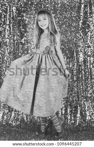 2a9132639aaf Child girl in stylish glamour dress, elegance. Fashion and beauty, little  princess. Fashion model on silver background, beauty. Little girl in  fashionable ...
