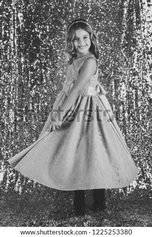 fde54933c31b Child girl in stylish glamour dress, elegance. Fashion model on silver  background, beauty. Fashion and beauty, little princess. Look, hairdresser,  makeup.