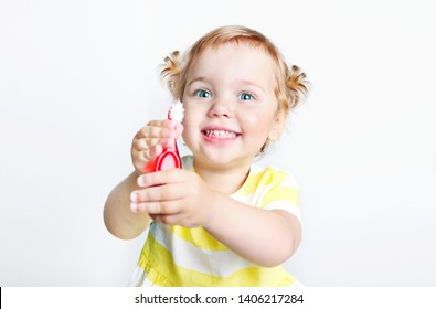 Child girl with toothbrush smailing happy face portrait.Tooth cleaning toddler.