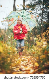 Child Girl with Umbrella in the Autumn Forest