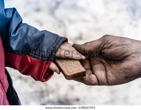 The child gives the man a piece of rye bread.