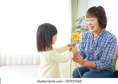 Child giving flower