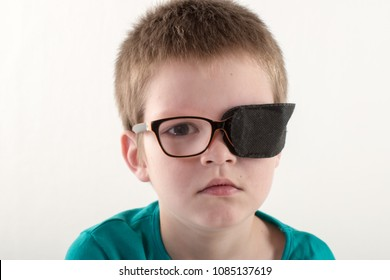 Child in glases with Occluder. 