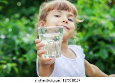 child glass of water. selective focus. Children