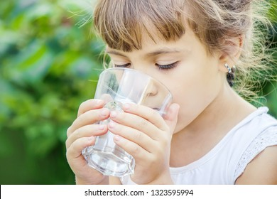 child glass of water. selective focus. food and drink. nature