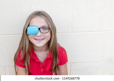 Child in glasses with Occluder. Ortopad Girls Eye Patches nozzle for glasses for treating strabismus (lazy eye)