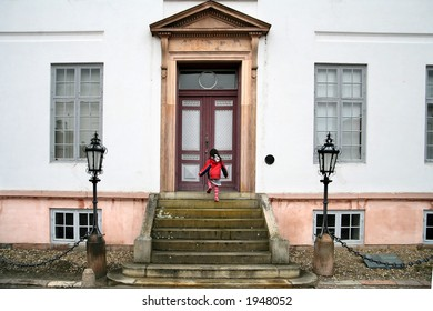 child going up a staircase back at home