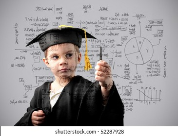 Child in graduate uniform writing some maths exercises