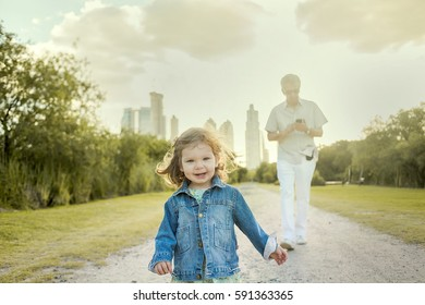Child and Grandfather walking in the Park.