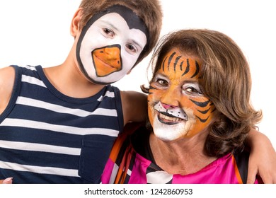 Child and grandmother with animal face-paint isolated in white