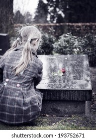 Child at graveyard grieving for loss of family or friend
