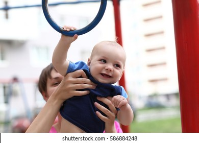 Child with gym ring at the outdoor playground