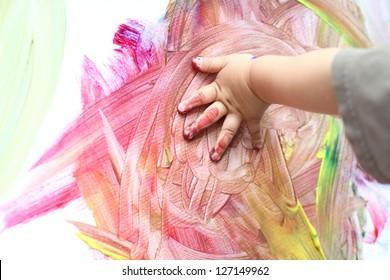 Child hand fingerpainting