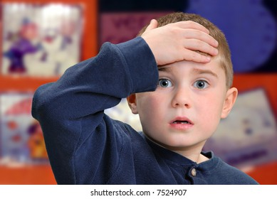 Child with hand to forehead