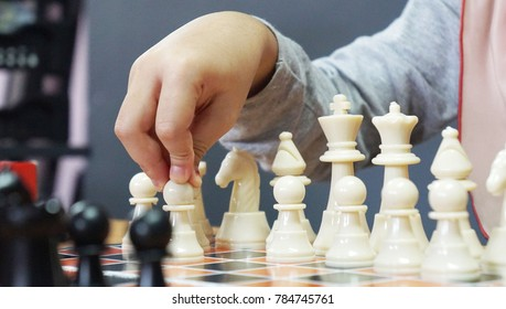 A child hand move pawn on chess games