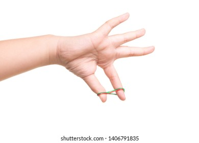 Child hand playing with elastic rubber band isolated on white background
