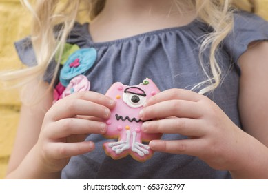 child hands with cookie