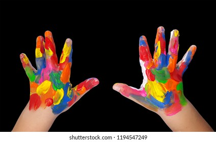 Child hands painted in colorful paints on black background