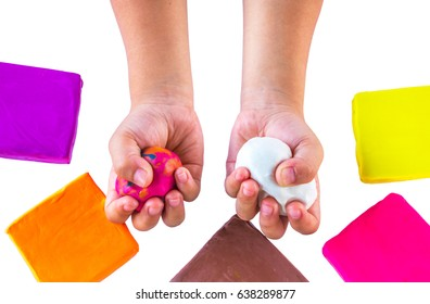 Child hands playing with colorful clay on with background.Concept of hand muscle development.