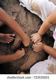 Child hands playing on sand. Childhood concept