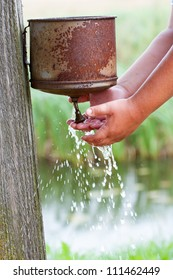 Child hands washing outdoors