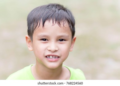 The child is happy with the face of the child with a lot of sweat.