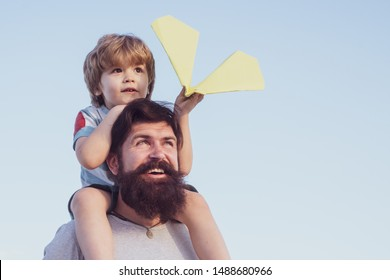 Child happy. Fathers day - father and son are hugging and having fun together