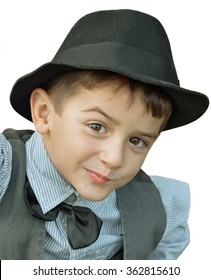 Child with hat and bow tie on a white background