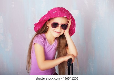 Child in hat and sunglasses