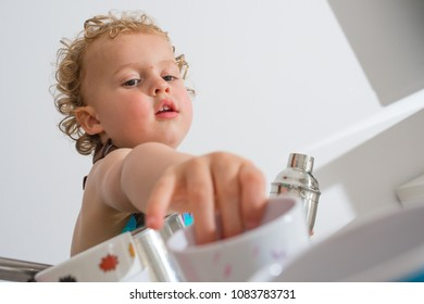 Child having fun cooking at home